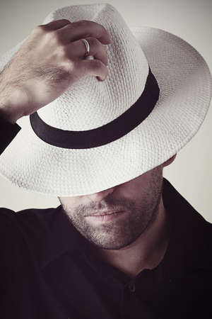 obscura: Mysterious man in white hat