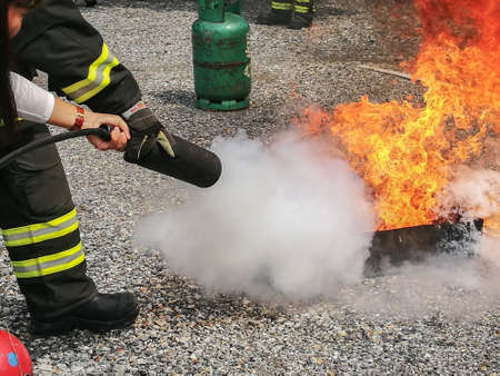 Firefighters trained how to use fire extinguishers.