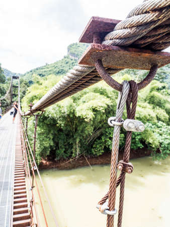 Rope bridge, the ways to across the river in some of the travel place or jungle , popular for extreme adventure travel Stock Photo