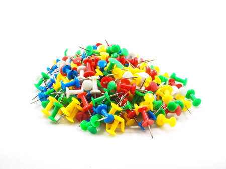 Group of colorful pins on white background Stock Photo