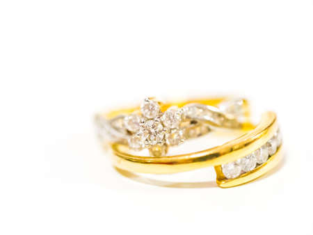 Two diamond engagement rings on blurred background