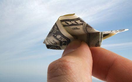 Airplane hergestellt aus Dollar banknote Standard-Bild - 2497642