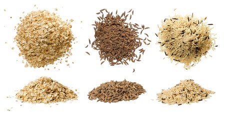 caraway: Closeups of oatmeal flakes, long rice mixed with wild rice and dried caraway isolated on white