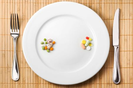 complementary: Drugs and beans on the plate illustrating choice between trditional and complementary medicine