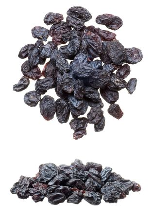 Closeup of black raisins heap isolated on white photo