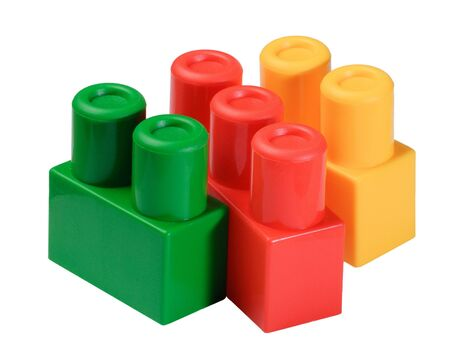 colorful toy building blocks stacks isolated on white photo