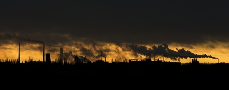 Landscape with a lot of chimneys polluting air Stock Photo