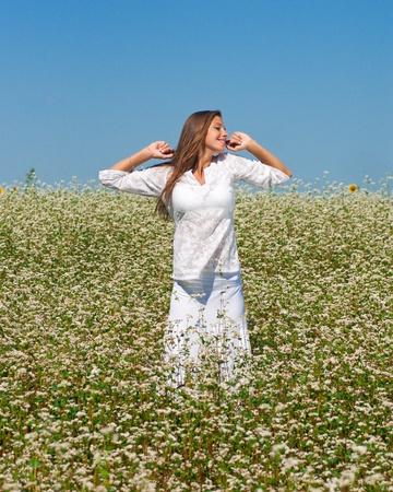 Beautiful girl on the field of  buckwheat photo