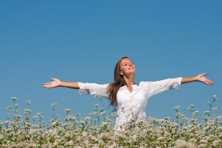 Beautiful girl on the field of  buckwheat