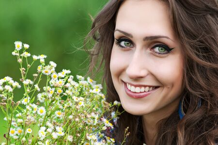 Portrait of beautiful girl with bunch of flowers