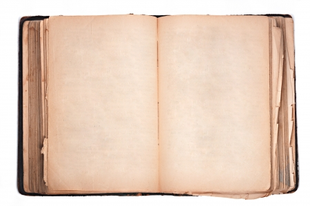 an old book with blank yellow stained pages