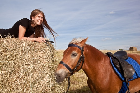 hay: Nice Girl with a Horse on the Field