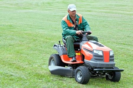 Professional lawn mowing by petrol lawn mower