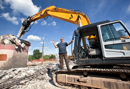 attachments: Ð¡onstructor with hydraulic hammer destroys reinforced concrete structures