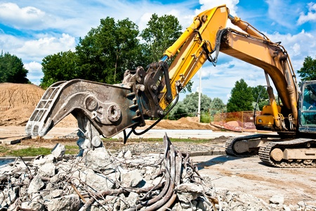 Concrete Crusher demolishing reinforced concrete structures