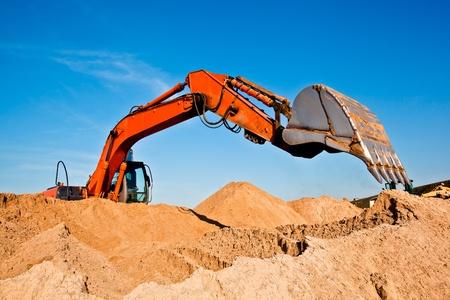 Excavator at a Sand Quarry 스톡 콘텐츠