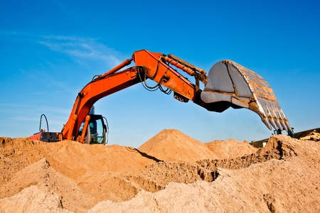 Excavator at a Sand Quarry Stock Photo