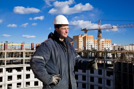 Construction worker at construction site showing OK hand gesture photo