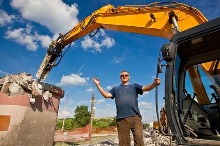 hydraulic: Demolition Expert pointing OK hand gesture Stock Photo