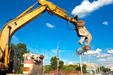 Commercial and Industrial Demolition with Hydraulic Crushing Hammers Stock Photo
