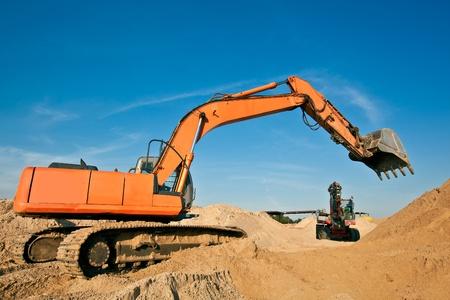 sand quarry: Excavators at  the Sand Quarry Stock Photo