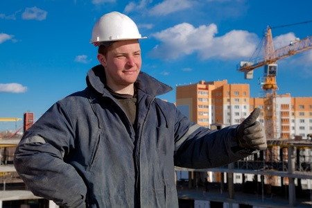 Foreman worker giving okay sign hand gesture at building area photo