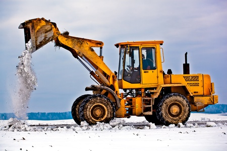 Wheel loader machine removing snow in winter from the road photo