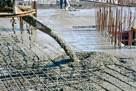Concrete pouring during commercial concreting floors of buildings at construction site photo