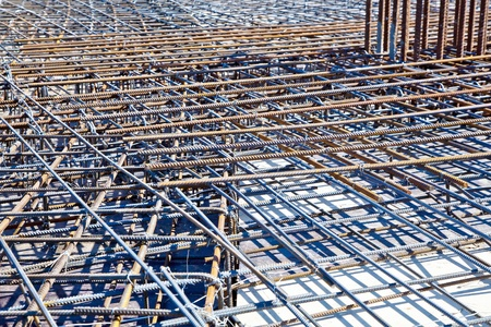 Steel bars for reinforcing concrete. Floor at construction site ready for a concrete pouring 스톡 콘텐츠