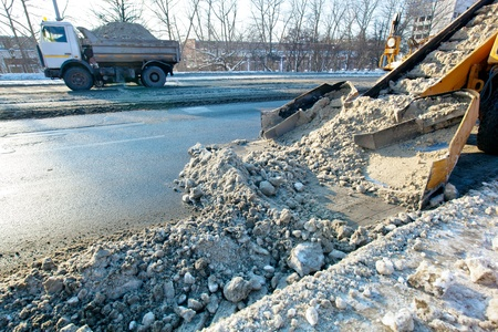 Municipal snow removal equipment at work  Snow thrower and dump truck cleaning city streets Stock Photo - 12538076