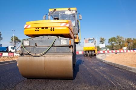 asphalting: Road rollers during asphalt paving works