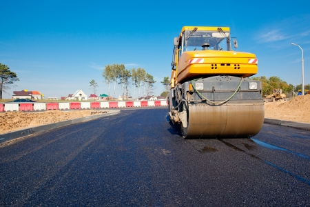 steam roller: Compactor at new road construction or repairing asphalt pavement works