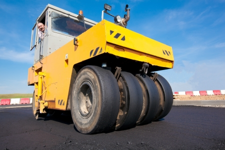 blacktopping: Compactor - Pneumatic Tyred Roller during asphalt paving  New road construction