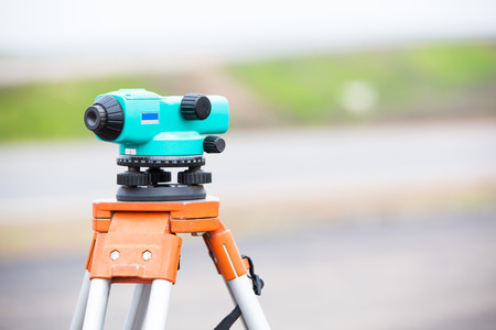 land surveying: Land surveying equipment theodolite during road works Stock Photo