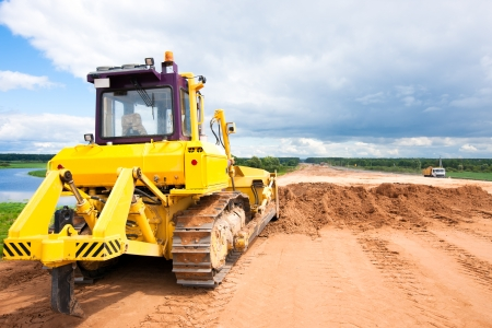 asphalting: Bulldozer during construction road works