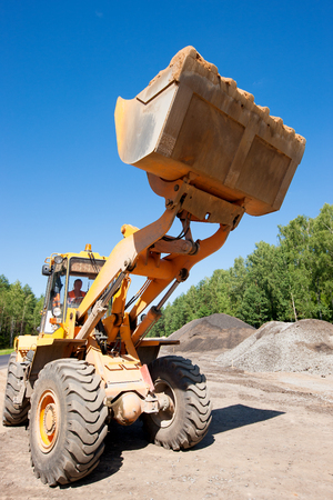 blacktopping: Wheel loader at construction site during road works