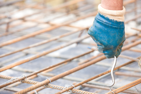 reinforcing bar: Installing binding wires to reinforcement steel bars during concrete pouring works
