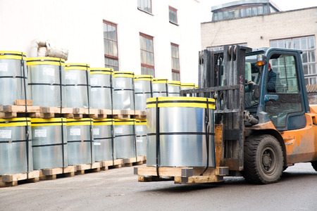 Forklift stacker transporting cargo with pallet Stock Photo