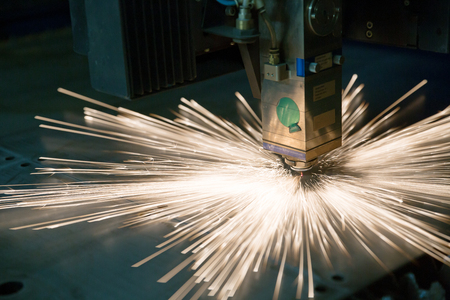 plasmas: Industrial laser during cutting metal works Stock Photo