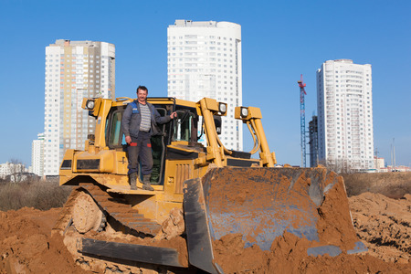 earth moving: Construction worker with bulldozer during earth moving works