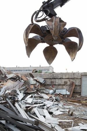 backhoe loader: Machine Loader with Hydraulic Crab Bucket uploads Waste Steel
