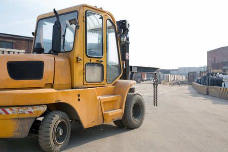 Forklift truck on factory road  photo