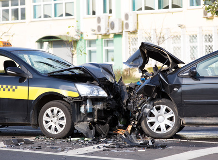 car wreck: Crashed cars automobile collision accident at city road