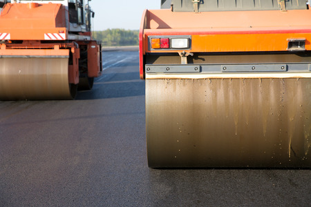 Road rollers during asphalt compaction works 스톡 콘텐츠