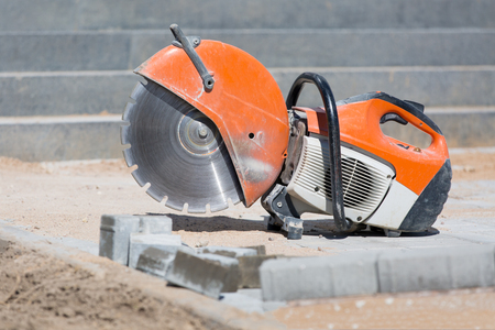 stone cutter: Concrete saw tool equipment at construction site Stock Photo