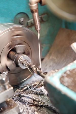 fluids: Metalworking industry: workpiece drilling on a lathe machine Stock Photo