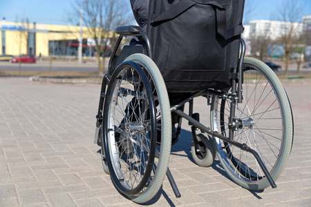 In wheelchair during walk in sunny day