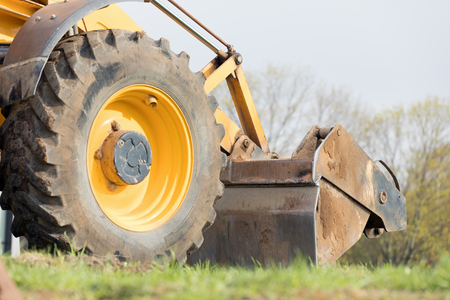 Wheel loader machine during earth mowing works