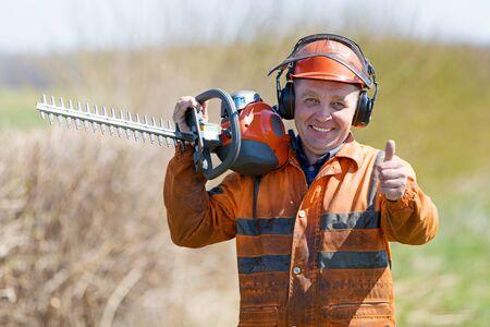 Happy Landscaper with Hedge Trimmer Tool gersturing Ok sign