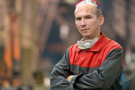 Portrait industrial man worker on manufacture workshop background